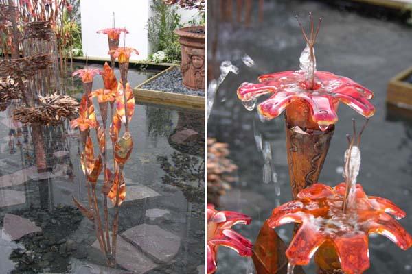 Halcyon vandkunst i kobber med mundblæst glasblomster